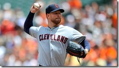 May 24, 2014; Baltimore, MD, USA; Cleveland Indians starting pitcher Corey Kluber (28) pitches in the second inning against the Baltimore Orioles at Oriole Park at Camden Yards. Mandatory Credit: Joy R. Absalon-USA TODAY Sports